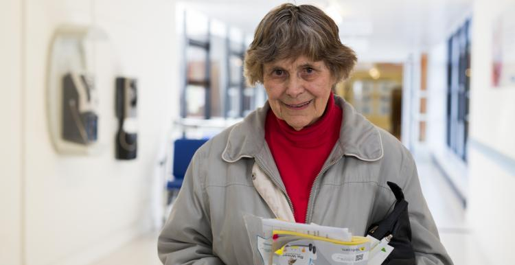 Older lady leaving hospital with info pack