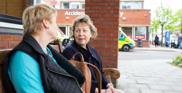 Two women talking at A&E
