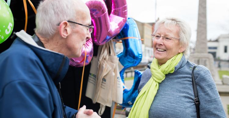 Volunteer talking to member of the public