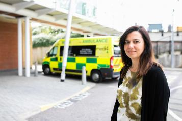 Woman standing in the ambulance bay of an A&E