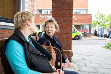 Two women talking at A&E