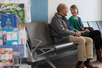 Two people talking in a waiting room