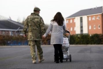 armed forces family walking