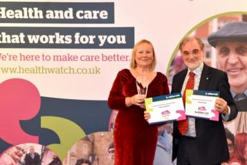 kate holt and dr david n jones with awards