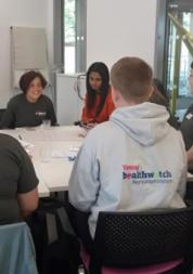 young healthwatch and northamptonshire young carers around a table at a meeting