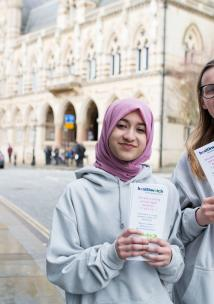 young healthwatch volunteers holding leaflets